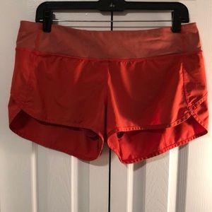 Red/orange Lululemon size 8 running shorts